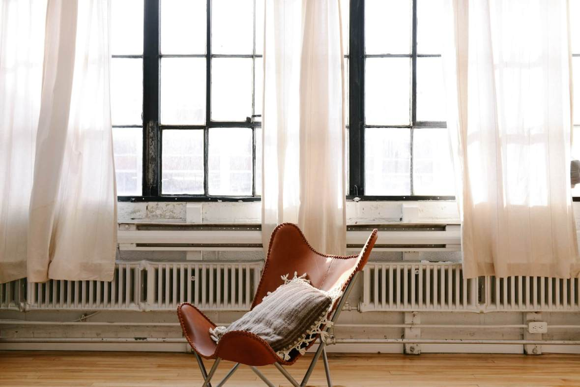 Leather chair in front of window - interior design